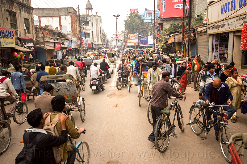 street traffic - cycle rickshaws, bicycles and motorbikes (india), bicycles, bikes, crowd, cycle rickshaws, india, motorcycles, moving, traffic jam, varanasi