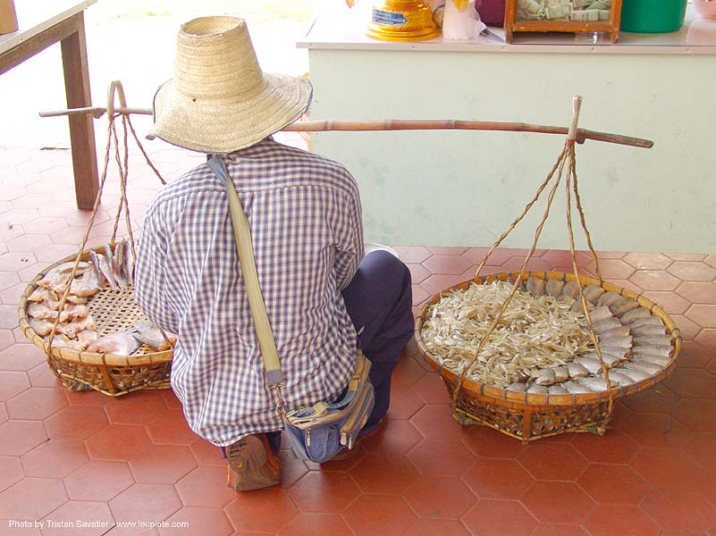 street vendor with twin baskets - thailand, fish, fish market, hat, people, straw hat, street market, ประเทศไทย
