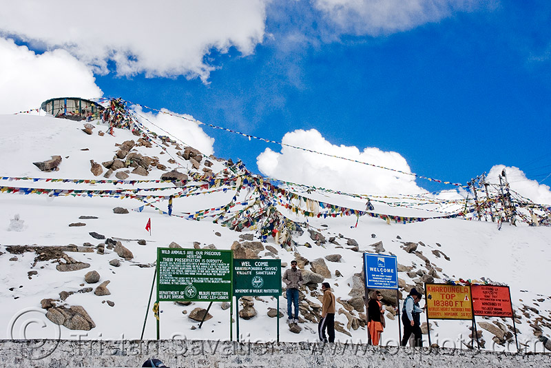 summit - khardungla pass - ladakh (india), buddhism, india, khardung la pass, ladakh, mountain pass, mountains, prayer flags, signs, snow, tibetan