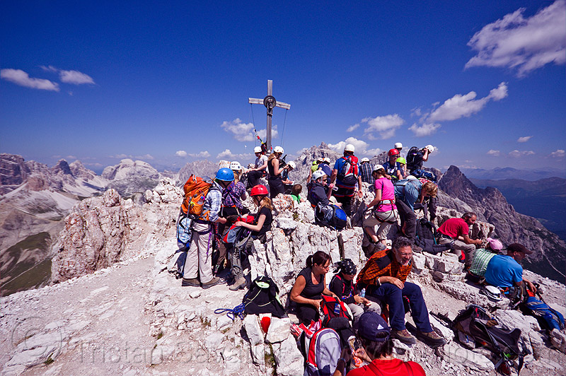 summit of monte paterno, alps, blue sky, climbers, climbing harness, climbing helmet, cross, crowd, crowded, crucifix, dolomites, montaineers, monte paterno, mountain climbing, mountaineer, mountaineering, mountains, parco naturale dolomiti di sesto, rock climbing, summit, via ferrata