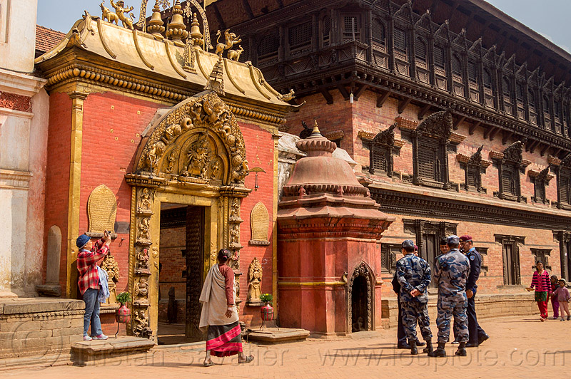 sundari chowk temple gate - bhaktapur durbar square (nepal), battledress, bhaktapur, durbar square, gate, guard, hindu temple, hinduism, military fatigues, nepalese army, soldier, uniform