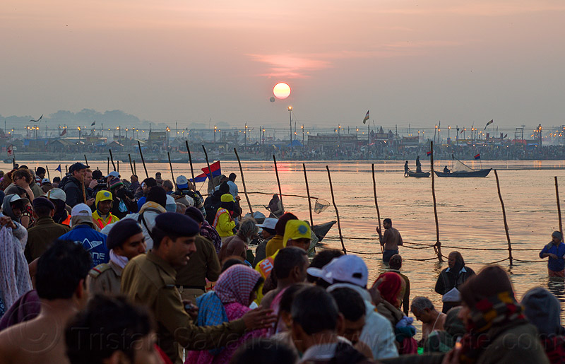 sunrise over the ganges river at sangam - kumbh mela 2013 (india), crowd, dawn, fence, ganga, ganges river, hindu pilgrimage, hinduism, holy bath, holy dip, india, maha kumbh mela, nadi bath, paush purnima, pilgrims, ritual bath, river bathing, river boats, triveni sangam