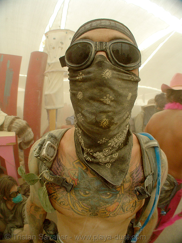 surviving the dust storm in center camp - burning man 2007, bandana, burning man, cat tattoo, dust storm, face mask, gato negro tattoo, goggles, playa dust, tattooed, tattoos, whiteout