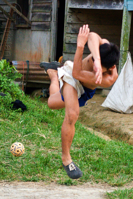 takraw player in twisted position (borneo), ball game, borneo, gunung mulu national park, kick volleyball, malaysia, man, panan, penan people, player, playing, rattan ball, sepak raga, sepak takraw, sport