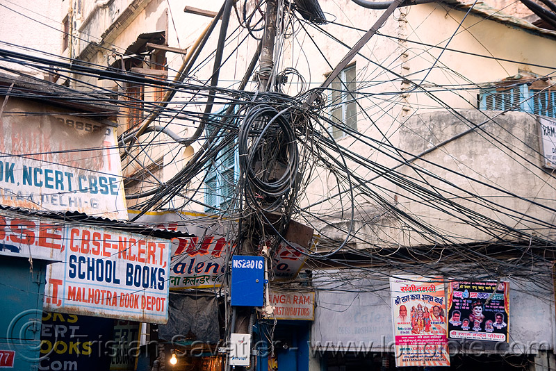 tangled electrical wiring in street, delhi, india