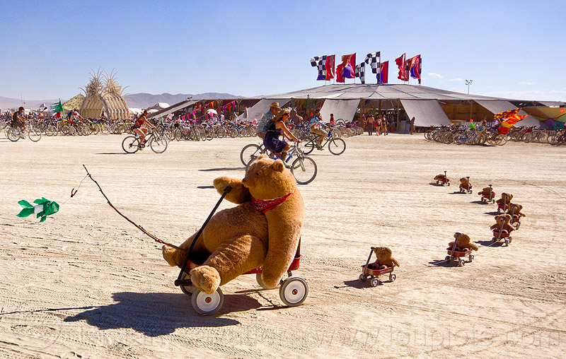 teddy bears train - burning man 2012, bear cubs, burning man, family, fish, fishing rod, mother bear, red carts, red wagons, rolling, string, teddy cubs, teddybears, train, unidentified art