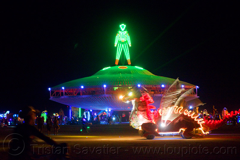 the man on the giant UFO at night - burning man 2013, art car, flying saucer, unidentified art, unidentified art car