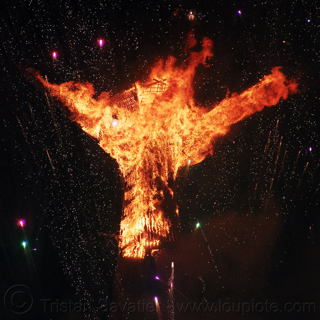 the man starts to burn - burning man 2015, burning man, fire, flames, night of the burn, the man