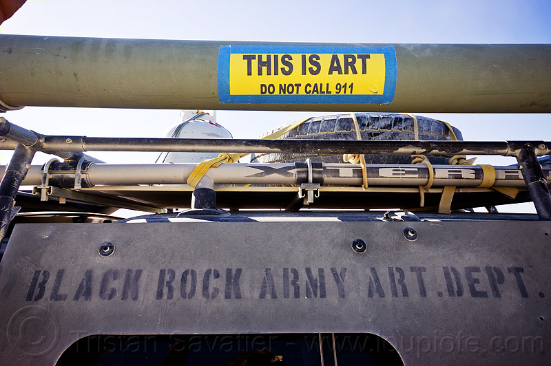 this is art - do not call 911 - burning man 2012, 911, armored, armoured, army, art car, burning man, military, stencil, vehicle