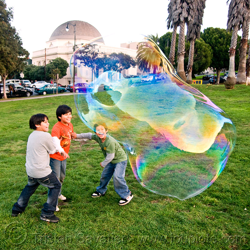 three kids and a giant soap bubble, big bubble, bubbles, children, dolores park, giant bubble, iridescent, people, playing, soap bubbles, turf
