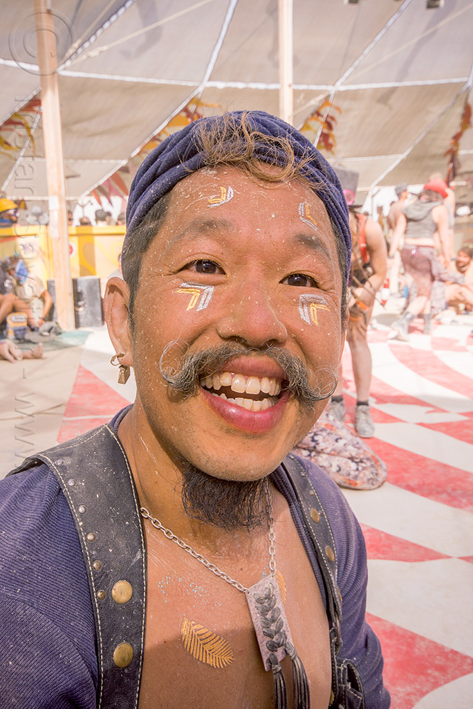 tim laurel at center camp - burning man 2015, dusty, moustache, mustache, necklace, people