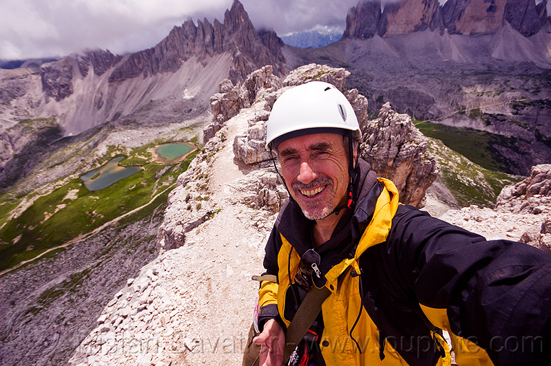 torre di toblino summit - dolomites, alps, climbing helmet, dolomites, ledge, man, mountain climbing, mountain jacket, mountaineer, mountaineering, mountains, parco naturale dolomiti di sesto, rock climbing, self-portrait, selfie, summit, torre di toblin, torre di toblino, tristan savatier, via ferrata