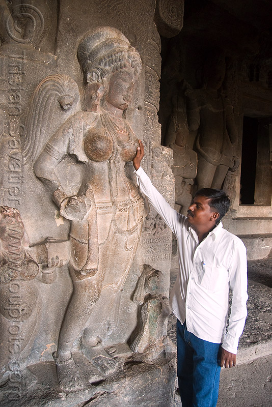 touching the breasts of the goddess brings good luck - underground hindu and buddhist temples - ellora caves (india), breasts, carving, ellora caves, hand, hindu temple, hinduism, man, river goddess, sculpture, statue, stone, woman