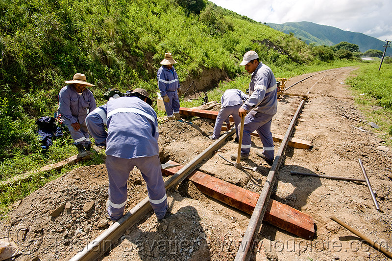 track maintenance - replacing wood railroad ties, men, metric gauge, narrow gauge, noroeste argentino, railroad construction, railroad ties, railroad tracks, rails, railway sleepers, railway tracks, single track, track maintenance, tren a las nubes, workers, working