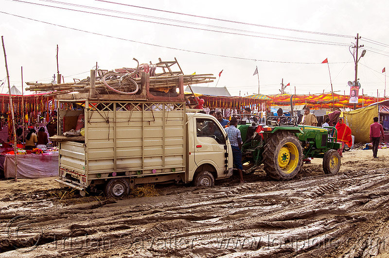 tractor pulling small truck stuck in mud (india), car, farm tractor, hinduism, kumbha mela, lorry, maha kumbh mela, mud ruts, muddy road, muddy street, towed, towing