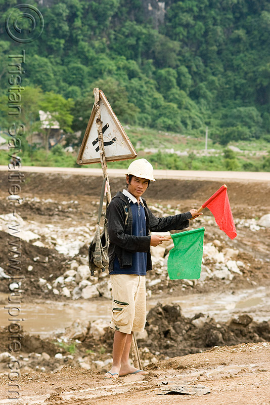 traffic semaphore - low-tech traffic control (laos), flags, green, people, red, roadwork