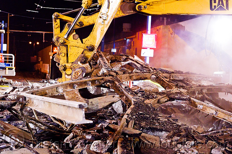 train track demolition, at work, bucket attachment, caterpillar, construction, excavator, excavator bucket, heavy equipment, light rail, machinery, muni, night, ntk, railroad, railroad construction, railroad tracks, rails, railway, railway tracks, san francisco municipal railway, track maintenance, track work, working