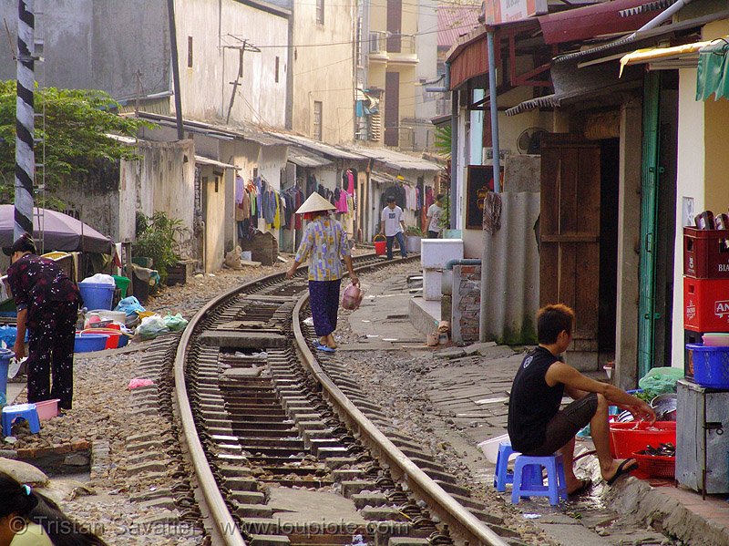 train track or street? - vietnam, curve, hanoi, houses, rail tracks, railroad tracks, railway tracks, single track, train tracks, vietnam
