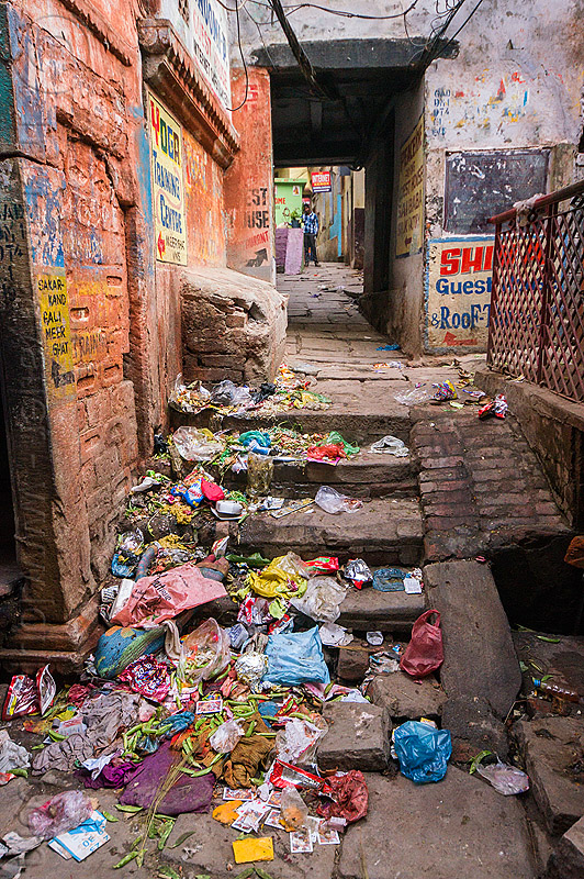 trash in narrow street - varanasi (india), environment, garbage, india, narrow street, plastic trash, pollution, single-use plastics, stairs, steps, varanasi