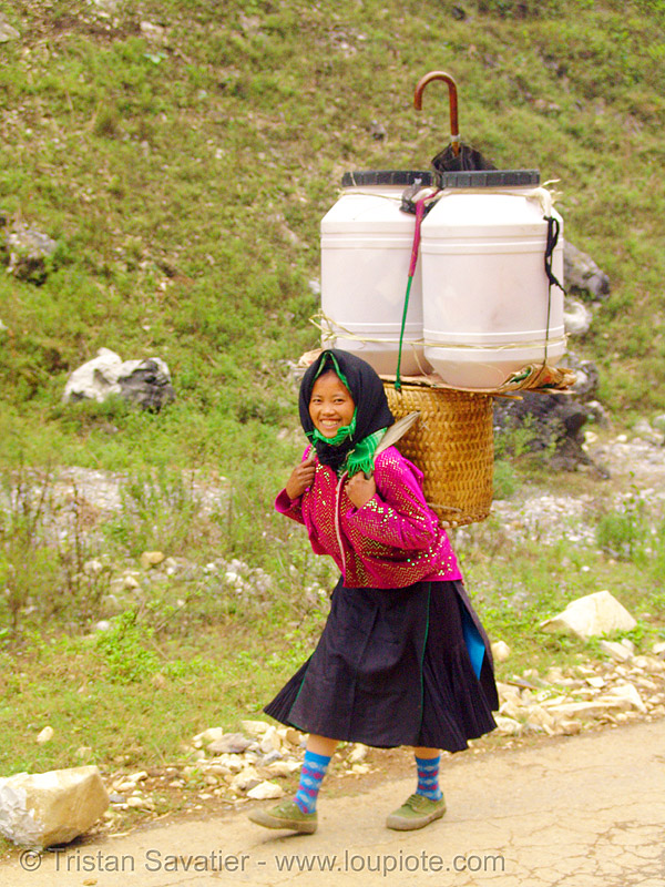 tribe girl with backpack - vietnam, asian woman, backpack, plastic cans, road, umbrella