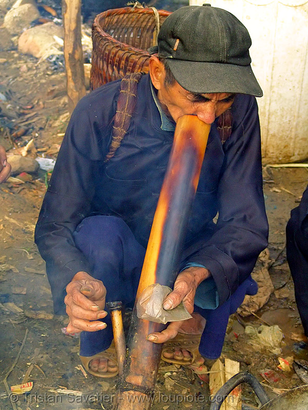 tribe man smoking tobacco with a bamboo pipe - bong - vietnam, bong, hill tribes, indigenous, man, market, mèo vạc, pipe, smoke, smoking, tobacco
