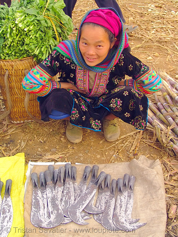 tribe woman selling billhooks at the market - vietnam, asian woman, flower h'mong tribe, flower hmong, hill tribes, indigenous, mèo vạc, people, sickle