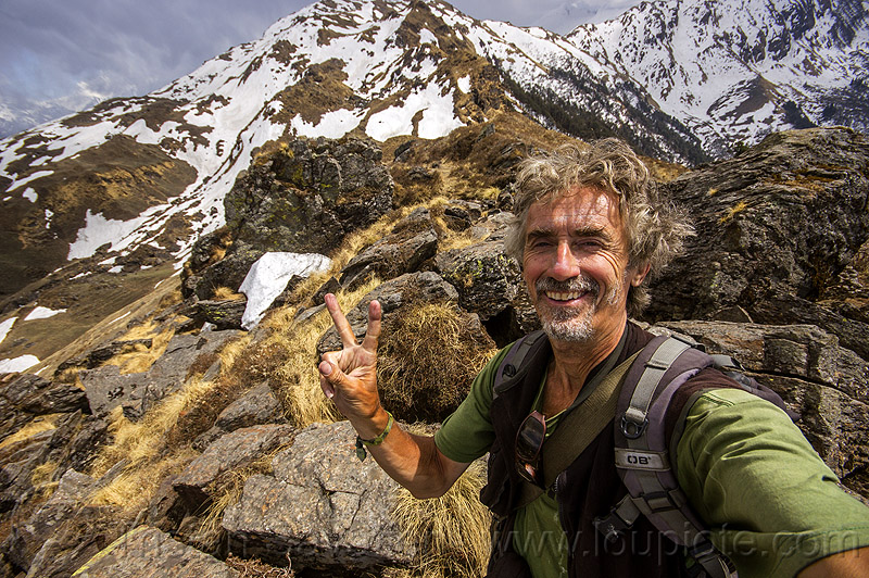 tristan savatier - mountain hiking in the indian himalayas near joshimath (india), hiking, man, mountains, peace sign, rocks, self-portrait, selfie, snow, stones, trekking, tristan savatier, v sign