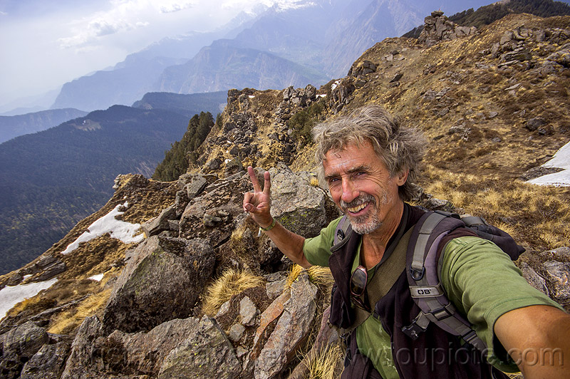 tristan savatier - selfie hiking in himalaya mountains near joshimath (india), hiking, india, man, mountains, peace sign, rocks, self-portrait, selfie, snow patches, trekking