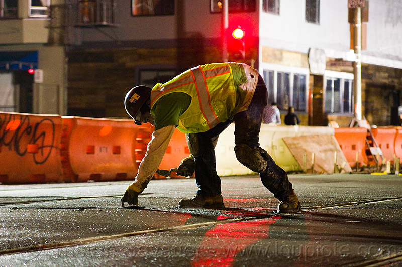 troweling the concrete, backlight, cement, concrete, high-visibility jacket, high-visibility vest, light rail, man, muni, night, ntk, railroad construction, railroad tracks, railway tracks, reflective jacket, reflective vest, safety helmet, safety vest, san francisco municipal railway, track maintenance, track work, trowel, worker, working