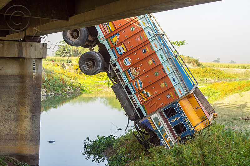 truck hanging off bridge - traffic accident (india), bridge, crash, crushed, hanging, india, lorry, overpass, river, road, tata motors, traffic accident, truck accident, west bengal, wreck