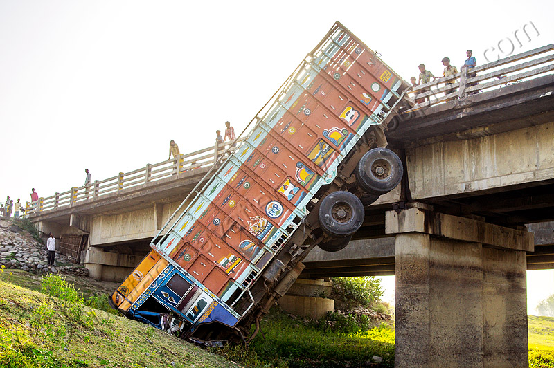 truck hanging off overpass - traffic accident (india), bridge, crash, crushed, hanging, lorry, overpass, river, road, tata motors, traffic accident, truck accident, water, west bengal, wreck