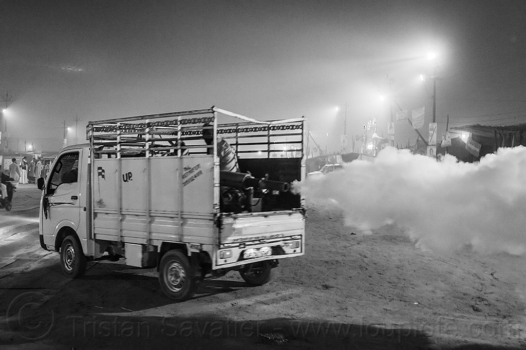 truck spraying DDT at kumbh mela 2013 (india), air quality, ddt, environment, fog gun, fog truck, fogger truck, fogging, hindu pilgrimage, hinduism, india, insecticide, lorry, maha kumbh mela, night, pollution, smog, spray, spraying, white smoke