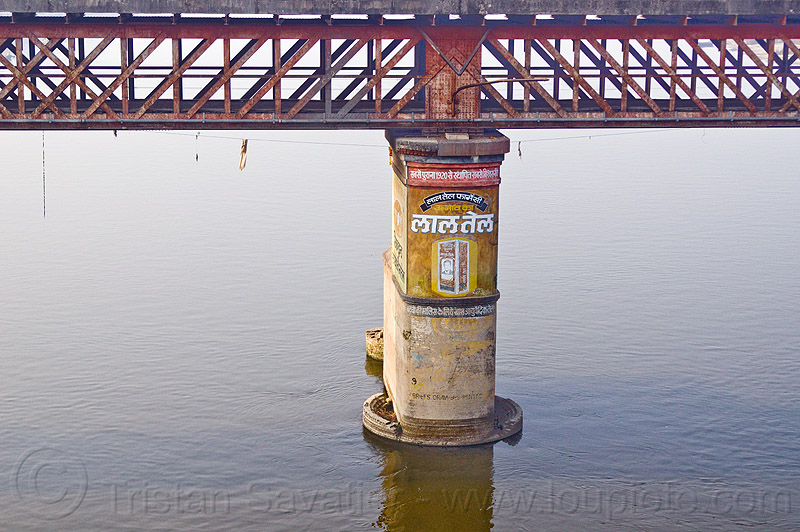 truss bridge pillar on ganges river (india), advertising, ganga, ganga river, metal bridge, painted, painted ad, water