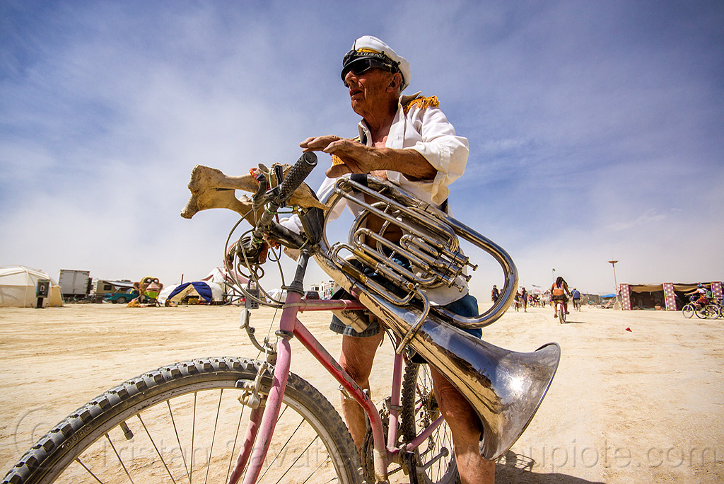 tuba player - burning band - burning man 2015, bicycle, cap, instrument, marching band, music, musical instrument, musician, people, riding, uniform, white uniform