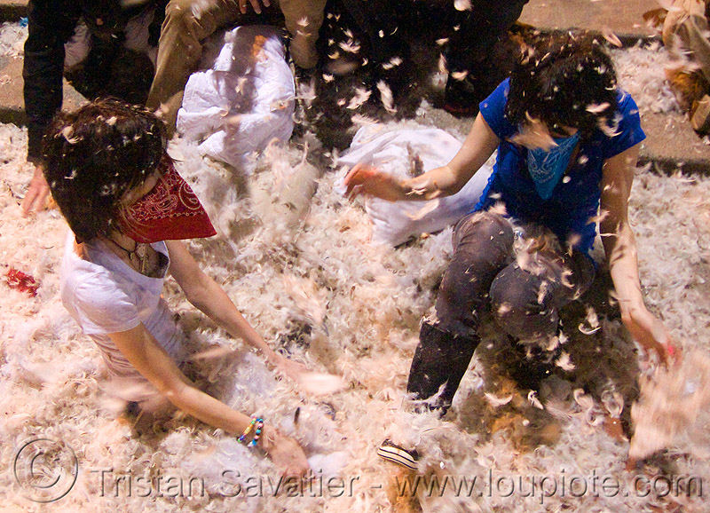 two girls in the feathers - the great san francisco pillow fight 2009 - olivia, bandana, down feathers, girls, night, olivia, pillow fight club, pillows, women, world pillow fight day