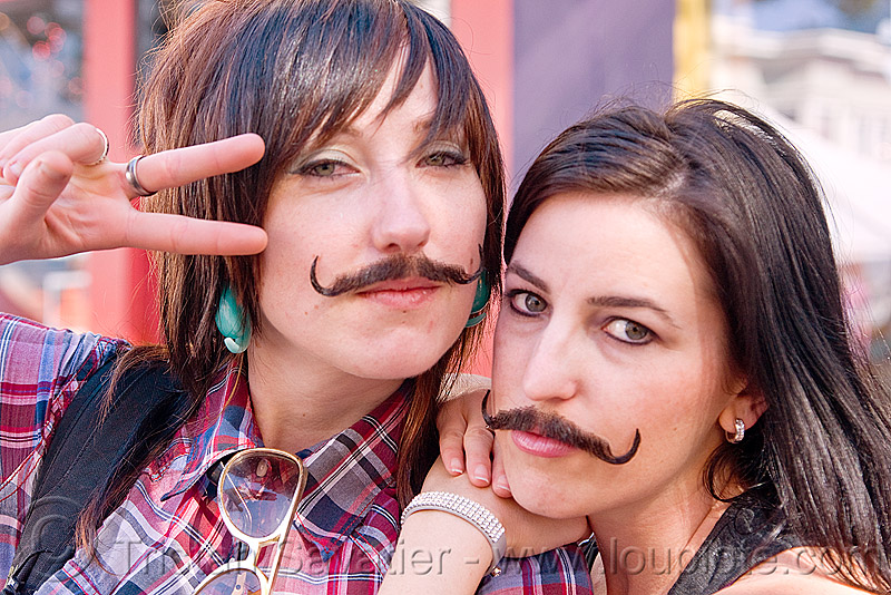two girls with false moustaches, fake moustaches, fake mustaches, false moustaches, false mustaches, haight street fair, mustache, sarah, women