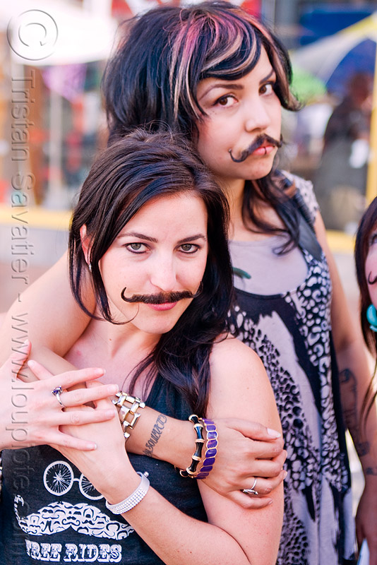 two girls with false moustaches, fake moustaches, fake mustaches, false mustaches, haight street fair, people, sarah, women