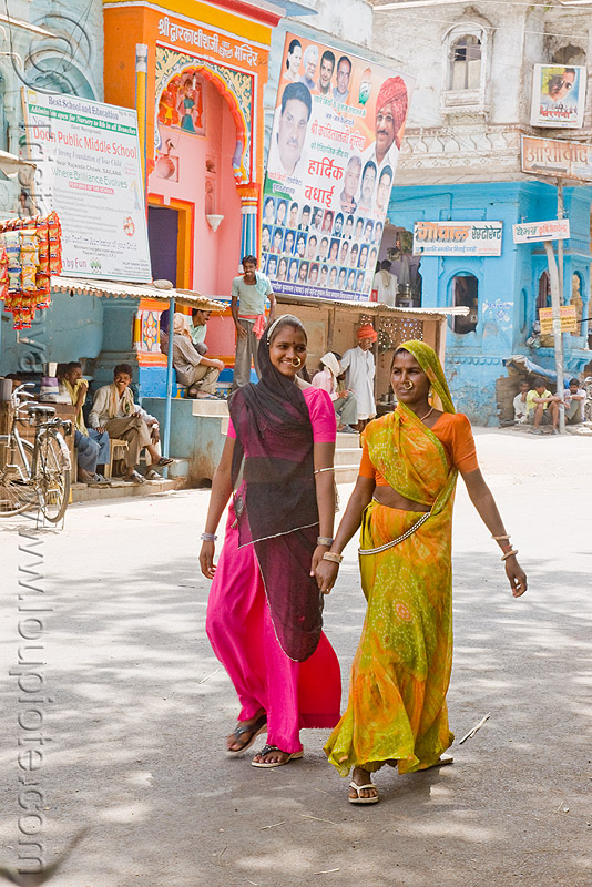 two young indian women holding hands (india), people, sailana, saree, sari, street, walking