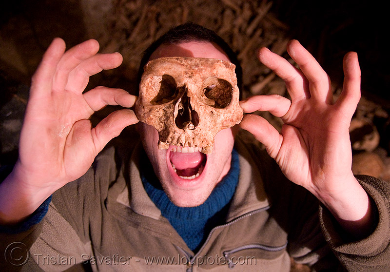 urban caver playing with a real human skull - catacombes de paris - catacombs of paris (off-limit area), bone, catacombs of paris, clandestines, dead, desecrated, desecration, human remains, human skull, illegal, ossuary, skeletal remains, skeleton, underground quarry