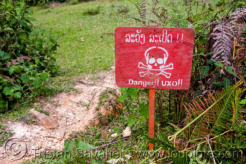 UXO LAO - unexploded ordnance (bombs from the vietnam war) - laos, bomb disposal, cross, crossbones, danger, explosive, landmine, lao national unexploded ordnance programme, military, red, safety sign, skull, skull and bones, skull n bones, unexploded bombs