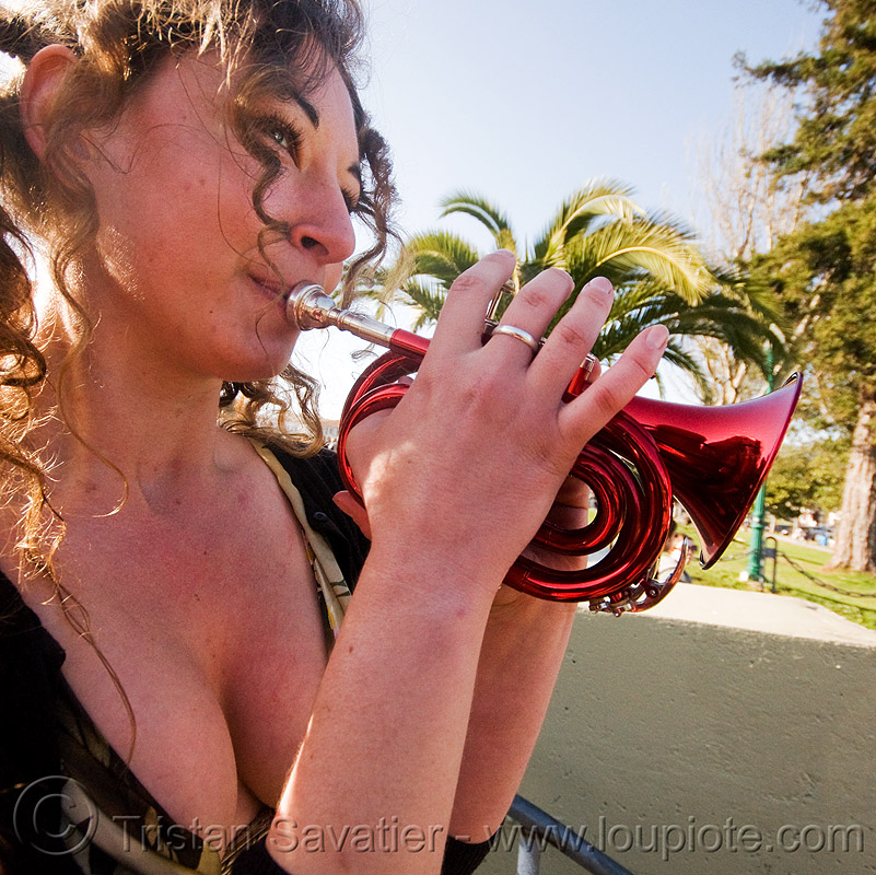 valerie playing a piccolo trumpet, brass, dolores park, musician, piccolo trumpet, playing music, red, small trumpet, valerie, woman