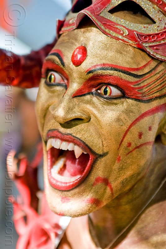 vampire - cat-eye yellow contact lenses - fangs - golden face paint, bindis, burning man, cat eyes, cat-eye contact lenses, center camp, color contact lenses, contacts, damon, damon knight, expression, people, red, special effects contact lenses, teeth, theatrical contact lenses, vampire fangs