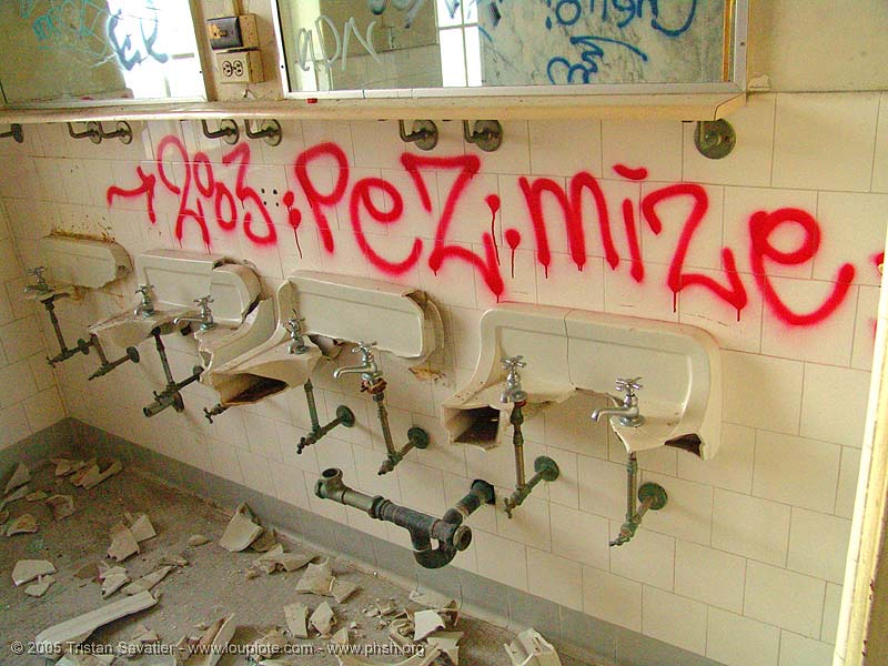 vandalism - vandalized bathroom - abandoned hospital (presidio, san francisco) - phsh, abandoned building, abandoned hospital, bathroom, decay, graffiti, pez, presidio hospital, presidio landmark apartments, sinks, toilet, trespassing, urban exploration, vandalism, vandalized