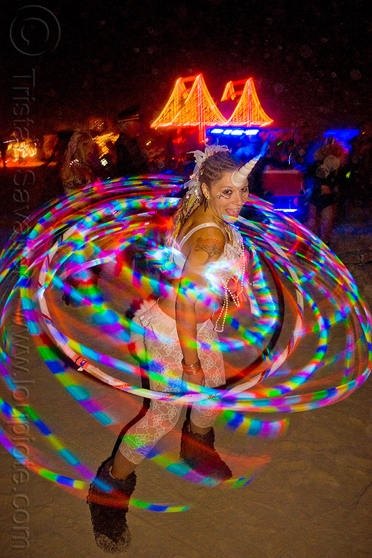 veronika - astrohoops - burning man 2009, astrohoops, burning man, costume, led hoop, led hulahoop, led-light, light hoop, long exposure, night, unicorn, veronika, woman