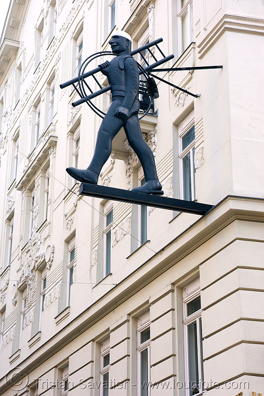 vienna - shop sign - man with ladder, wien