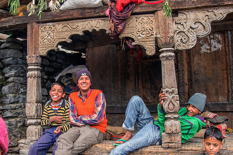 village kids sitting in front of old traditional house with wood carvings (india), boys, carved, children, columns, intricate, janki chatti, knit cap, people, wood carving