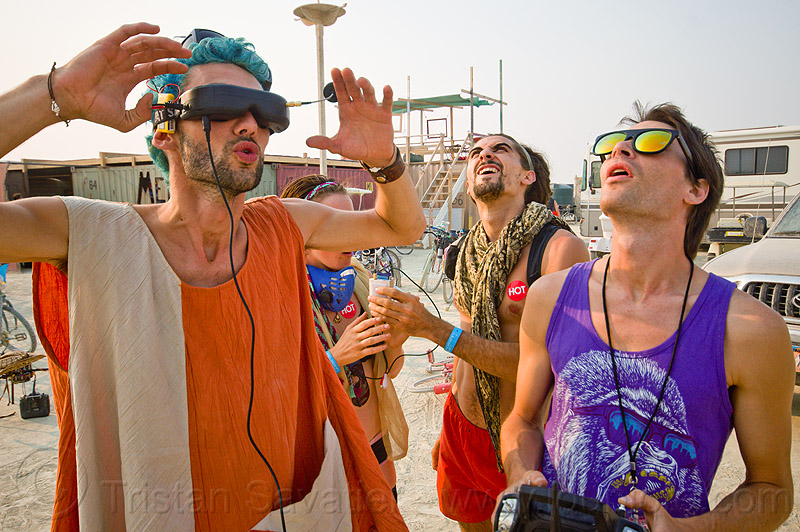 virtual reality video feed from remote controlled drone - burning man 2013, men, people, rc, uav, unmaned aerial vehicle, virtual reality goggles, vr goggles
