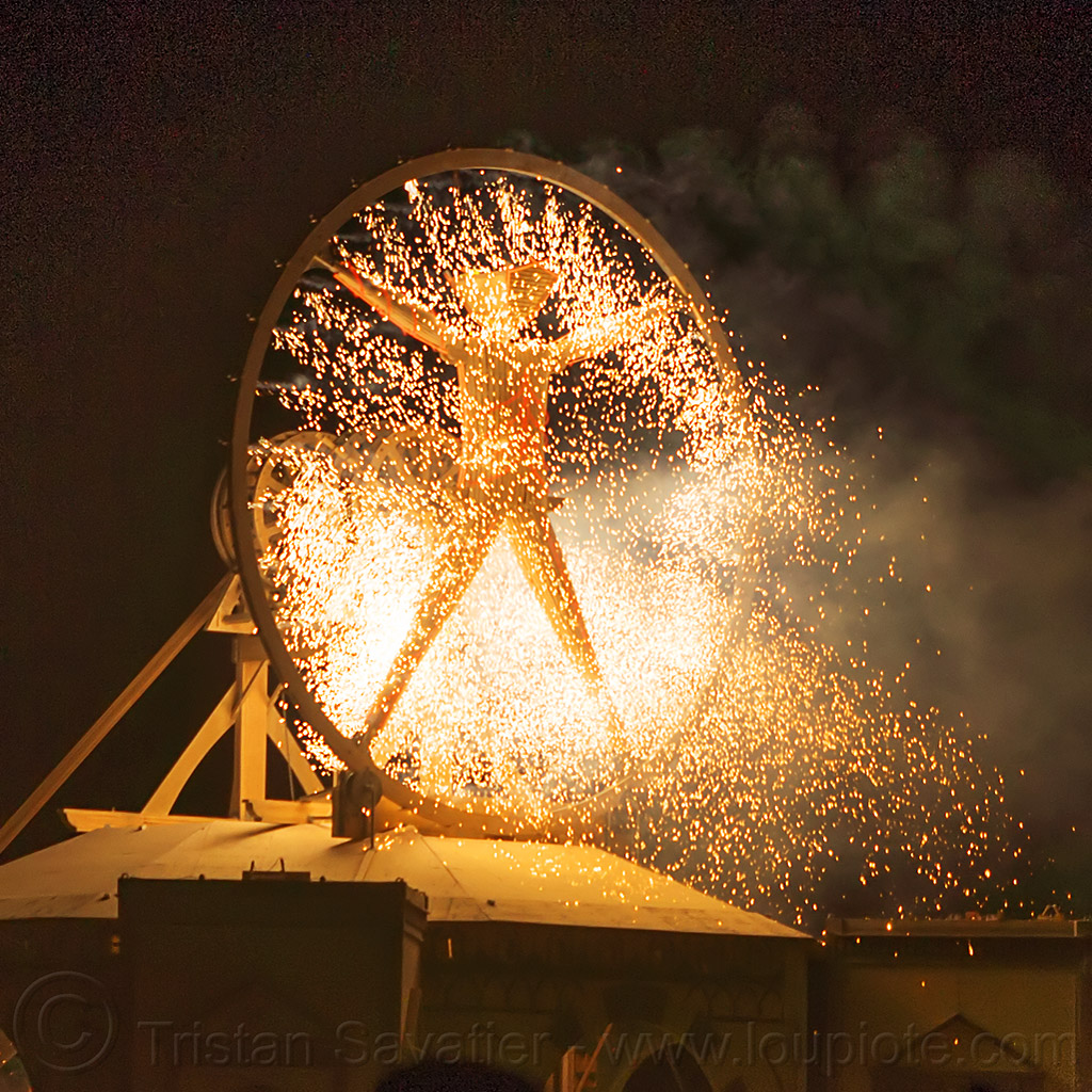 vitruvian man burns - burning man 2016, burning man, fire, fireworks, night, pyrotechnics, sparks, the man, vitruvian man