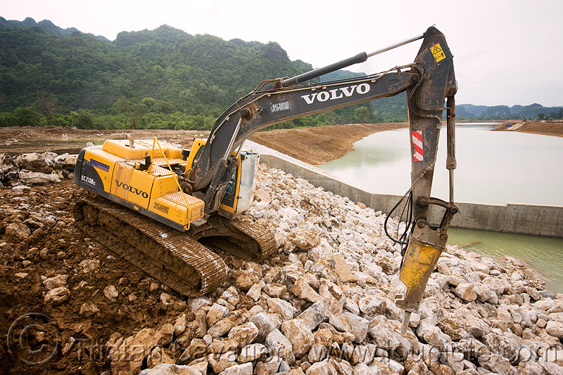 volvo EC210 excavator - downstream canal - nam theun 2 hydroelectric project (laos), at work, attachment, construction, hydraulic breaker, hydraulic hammer, hydro-electric, laos, nam theun 2 hydroelectric project, nam theun power company, ntpc, rocks, rubble, volvo ec210, volvo ec210b excavator, volvo ec210blc excavator, volvo excavator, working