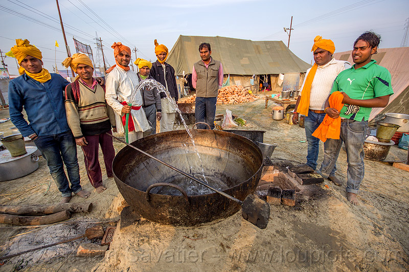 washing a large cooking pot in an ashram (india), big, group, huge, kumbha mela, maha kumbh mela, men, people, water hose